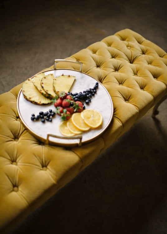 Food styled on a yellow bench